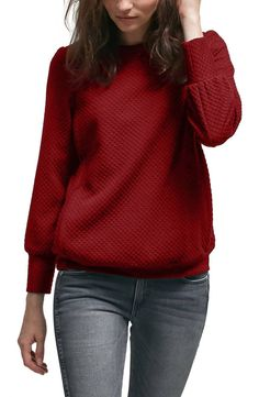 Stay cozy and chic in this textured sweater cut from an ultrasoft triblend with side panels that provide easy and discreet nursing access.