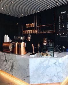 Bronze LaMarzocco espresso machine + beautiful coffee shop layout