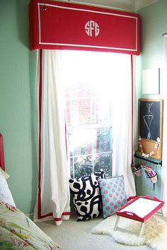 Monogrammed window treatment over burlap roman shades would look FANTASTIC. Use foam or mdf board, wrap & staple fabric. Use iron on fabric backing & either a crickut machine or exacto knife to cute out letters! Easy peasy!