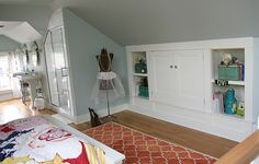 Everything about this awesome attic bedroom/bath combo is adorable!