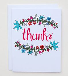 "This charming thank you card features hand-drawn floral arches surrounding a hand-lettered ""Thanks"" in a rosy red. Available as a single card paired with a 100% recycled white envelope and packaged in"