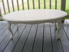 Love the oval shape and french charm of this coffee table!