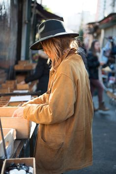 This has me written all over it- rummaging through a flee market- oversized coat- hat... Check, check and check.