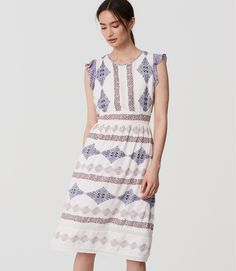 """Adorned with a delicate floral motif and femme flutter sleeves, this midi exudes purely bohemian beauty. Round neck. Flutter cap sleeves. Shirred beneath waist. Back zip. Lined. 27"""" from natural waist."""