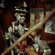 An altar for Baron Samedi one of the Lao in Haitian Vodou. Went on a Voodoo tour in the French Quarter this morning. He sure loves his rum and tobacco! :) Super interesting tour! #marielaveau #baronsamedi #vodou #voodoo #frenchquarter #neworleans by marynroos