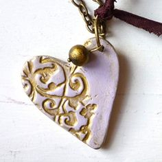 Melina uses eco-friendly cold porcelain to make beautiful necklaces. Good website!!!