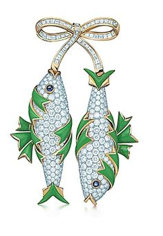 Two Tiffany diamond and enamel fish hanging from a diamond bow.