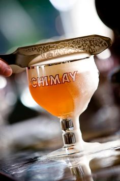 Chimay Triple -- a golden colour, the Trappist beer combines sweet and bitter in a rare balance. The beer's aroma felt in the mouth comes from the hops' perfumes: above all, they are fruity touches of Muscat grapes and raisins, even ripe apples