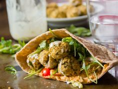 A healthier (but delicious) take on falafel! This quinoa falafel is baked instead of fried, and stuffed into pita loaves with creamy hummus and veggies!