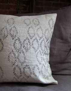 """Hemp Printed Cushion Cover by untold imprint :: Rustic, soft hemp is screen printed in deep chestnut brown. 18"""" square. 100% Hemp. Printed with non-toxic water-based ink. Envelope style construction. One edge of back closure is left as raw selvedge. This listing is for the pillow cover only, insert is not included."""