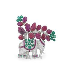 AN ART DECO RUBY, EMERALD AND DIAMOND ELEPHANT BROOCH