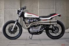 The venerable Yamaha XS650 has been a hit with racers and bike builders since the late 1960s. Here's one of our favorite XS650 customs from recent years, Drogo Michie's flat tracker. How's that for an exhaust system?