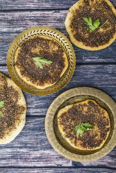 You are looking at the National Breakfast Dish of Lebanon. The almighty Zaatar manoushe (manouche, manou'che, man'ouché, fatayer, Lebanese pizza). There are different flavours of manoushe but the Zaatar one is...
