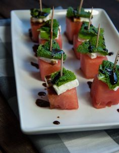 These watermelon feta mint skewers are refreshing as is, but the tangy balsamic glaze makes this healthy appetizer absolutely delicious - Feasting Not Fasting