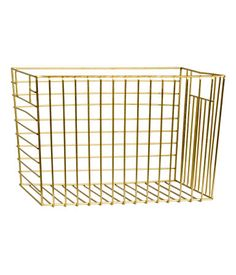 Large rectangular basket in metal wire with a handle at each side. Size approx. 8 x 8 3/4 x 11 3/4 in.