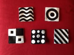 Black and white felt toy for baby (back is in reverse colours).