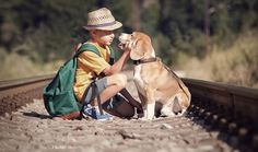 Little boy with his dog sitting on the railway Little Boys, Cowboy Hats, Couple Photos, Animals, Link, Funny, People, Diy Dog, Saying Sorry