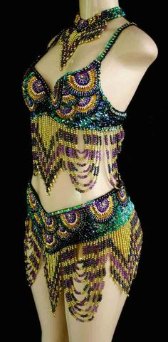 A completely beaded two piece outfit. Perfect for Mardi Gras!