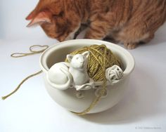 Reserved for Jan - Winter White Sculpted Cat Yarn Bowl with a ball of yarn by CedarPocket on Etsy https://www.etsy.com/listing/114840607/reserved-for-jan-winter-white-sculpted