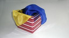 Here's a magic box that you can make to produce ribbons or a small handkerchief. It's a fun construction project and the trick is easy to learn and perform and is perfect for kids. Furthermore, it's a trick that a kid can perform in a show. Have fun with this one.