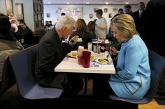 Hillary Clinton and her husband, former U.S. President Bill Clinton eat breakfast at the Chez Vachon restaurant in Manchester, New Hampshire, on Feb. 8, 2016.
