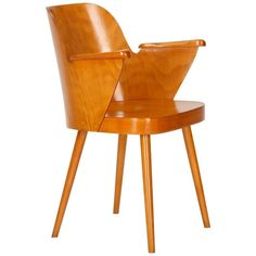 Mid-Century Czech Armchair by Oswald Haerdtl for Ton, 1955 | From a unique collection of antique and modern dining room chairs at https://www.1stdibs.com/furniture/seating/dining-room-chairs/