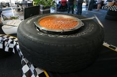 fun idea for a party of race car fans -beans served up in a tire
