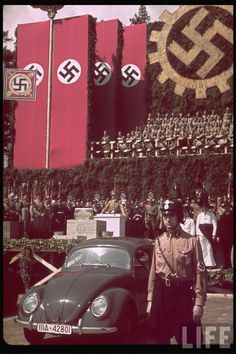 Hitler speaking at Fallersleben Volkswagen Works cornerstone ceremony, with Volkswagen Beetle on display. (near Wolfsburg). Fallersleben, Germany, June Photo by Hugo Jaeger Nagasaki, Hiroshima, World History, World War Ii, Kdf Wagen, Germany Ww2, The Third Reich, Fukushima, Military History