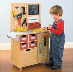 """LilSugar.com shows off our """"Just like Dad's"""" workbench.  """"Talk about a realistic-looking toy! One Step Ahead's workbench features a peg board, cubbies, and a paper roll so tots can plan out their work before getting started."""""""