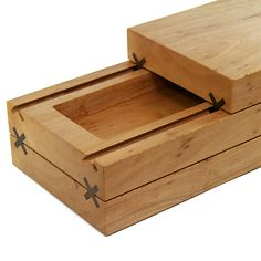 Our sliding wooden chest made from three solid pieces of London Plane. The chunks of wood use American black walnut X shaped runners to glide open allowing access to the two compartments.The perfect place to keep Jewelry, trinkets and other collections.