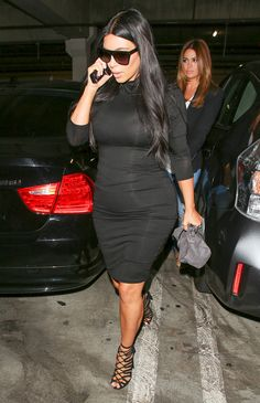 The stunner opted for a monochromatic look and paired her body-hugging dress with cutout booties, oversized sunglasses, and a gray suede clutch.