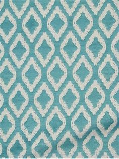 "Sand Turquoise.  Outdoor fabric for outdoor upholstery, drapery, cushions or pillow covers. Yarn dye reversible jacquard ikat diamond pattern. 30% poly - 70% polypropylene. 3.5"" repeat. 60"" wide."