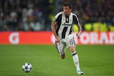 Mario Mandzukic of Juventus in action during the UEFA Champions League Quarter Final first leg match between Juventus and FC Barcelona at Juventus Stadium on April 11, 2017 in Turin, Italy.