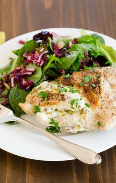 This recipe is a classic example of cooking by feel. I had some goat cheese left over from an appetizer, and I found fresh, green garlic at the farmer's market. So I came up with a way to use them together — stuffed inside some bone-in chicken breasts. It's really remarkable the way a little garlic and goat cheese can transform a plain and unglamorous chicken breast!