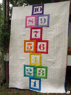 for the back of an I Spy game quilt...or maybe twister....Love Affair With My Brother...: Hopscotch Quilt