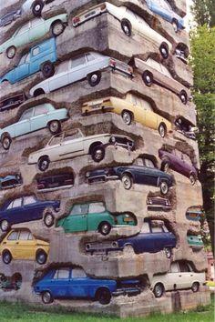 """""""Long Term Parking"""" by Arman is made up of 60 cars in concrete; Accumulation of 60 automobiles in concrete. 19,5 m. Parc de sculpture Le Montcel, Jouy-en-Josas, France"""