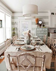 What a great updated French Country dining room with seafoam green grey striped walls!  #kathykuohome.com #FrenchCountry