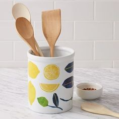 This citrusy utensil holder. | 48 Inexpensive Pieces Of Decor That Will Make Your Home Look Fancy