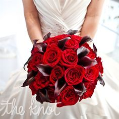 Tammie's bouquet was created from a combination of red roses and red calla lilies.  from the album: A Red and Black Wedding at the W Dallas-Victory Hotel