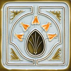 An Art Nouveau tube line tile with a four flower, ovoid medallion, and corner flash design in caramel and olive...