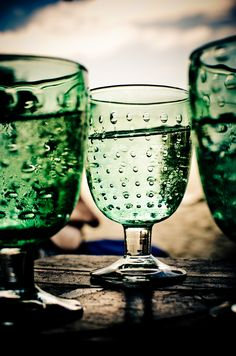 Would you like a drink in one of my green glasses?