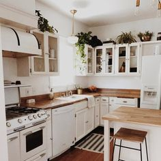 white kitchen with wood accents - Farmhouse Kitchen - accents ., white kitchen with wood accents - Farmhouse Kitchen - accents # kitchen Kitchen Dining, Kitchen Decor, Kitchen Plants, Warm Kitchen, Kitchen White, Kitchen Layout, Kitchen Ideas, Tiny House Loft, Wood Accents