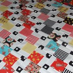 Sock Monkey And Polka Dots For The Cancer Kids /// quilting // 3rdRevolution-  Just a disapperaing nine patch plus the falling charms from Jenny Doan.  If you stop by I let you know the secret of forming the secondary design of the dots.  It's all in the layout.