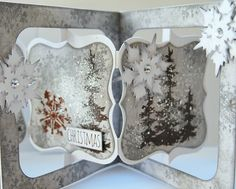 A lovely Christmas card with unusual colours of brown and grey. I love the trees and stacked snowflakes!