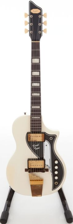 Late-1950s Supro Dual Tone White Solid Body guitar..