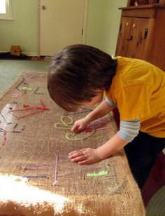 Tapestry Table! My children and grandchildren loved using large, blunt tapestry needles and yarn to create designs. This is a perfect way to have a stable canvas for such art--replacing the top of a coffee table with burlap.