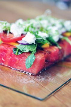 watermelon salad, Went to dinner last night had slice of watermelon or cantaloupe or honeydew, then a piece of mozzarella, piece of fresh mint w/ oil and balsmaic vinegar. YUM!