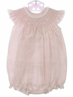 Adorable smocked bubble with angel wing sleeves for baby.
