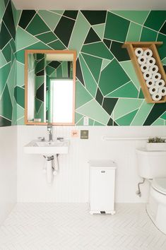 green bathroom with painted geometric walls