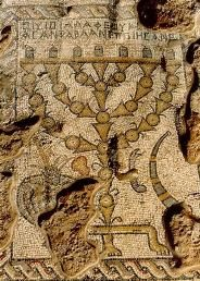 "The synagogue was found in the northern part of Zippori. These mosaics are different than the other mosaics that have been found in Zippori. Built during the first half of the 5th c. C.E. the most significant remnant of the synagogue is the ""long carpet"" of its mosaic floor with depictions of a zodiac and common Jewish symbols like the Holy Ark with a seven-branched Menorah on either of its sides, and also biblical scenes, including tabernacle/temple depictions of the binding of Isaac."